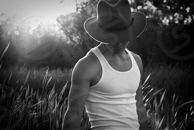 man wearing tank top grayscale photography photo