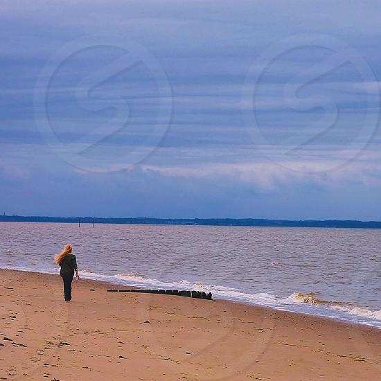 person walking on beach photo