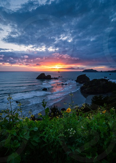 A very colorful and dramatic sunset over the Pacific Ocean. photo
