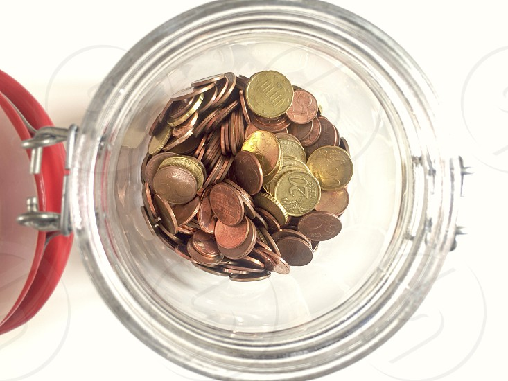 glass jar with euro coins photo