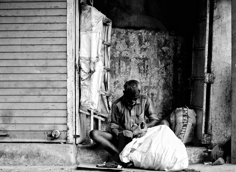 an old man from the streets of Mumbai Surviving. photo