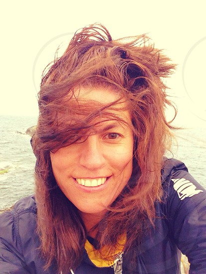 woman wearing a black zip up jacket photo