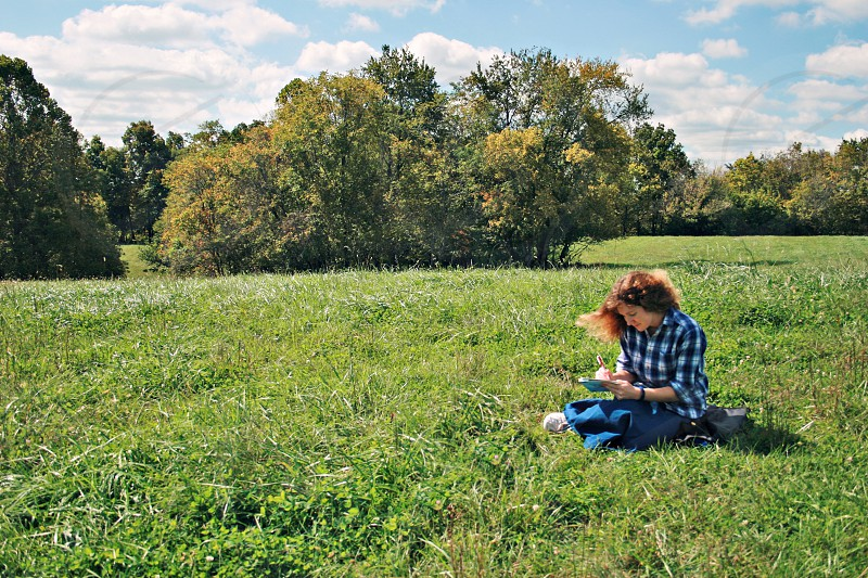 Writing letter in field photo
