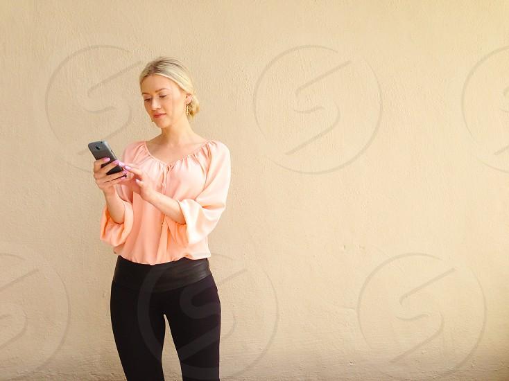 woman in beige scoop neck shirt photo