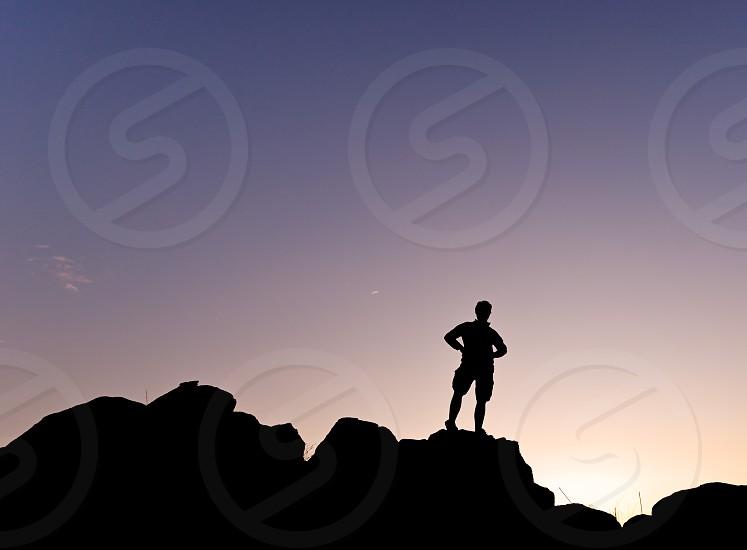 man boy young silhouette backlit climber climbing sport top mountain effort sky sunset sunrise horizontal photo