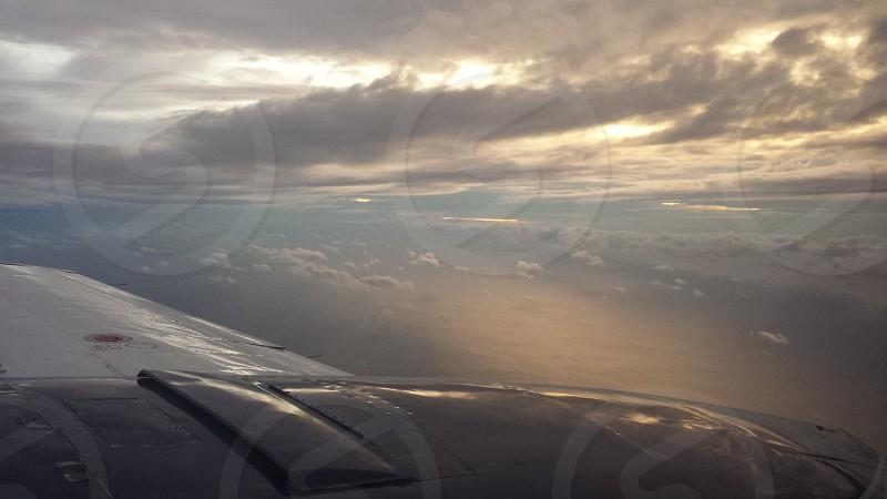 Airplane sunset clouds sunray photo