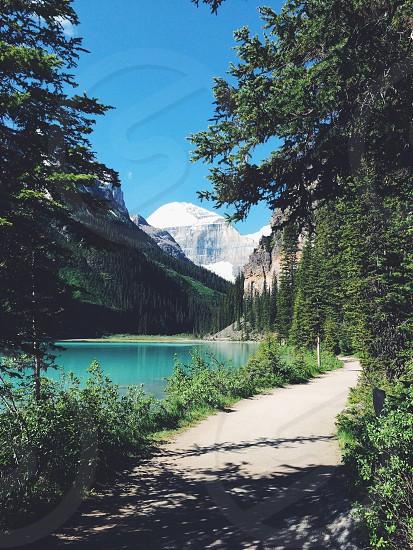 path near mountain lake photo