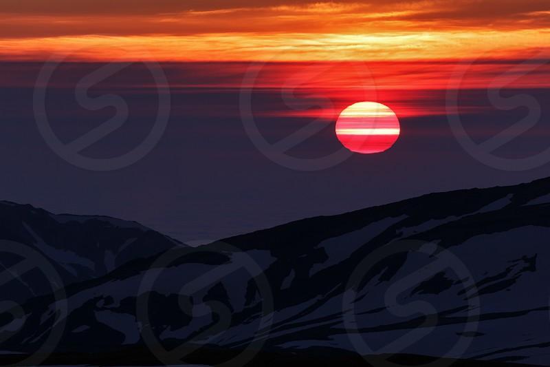Beautiful sunrise in mountains on Kamchatka Peninsula. Russia Far East. photo