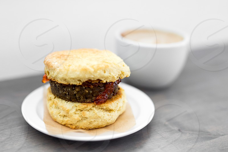 Vegan sausage breakfast sandwich on a biscuit. photo
