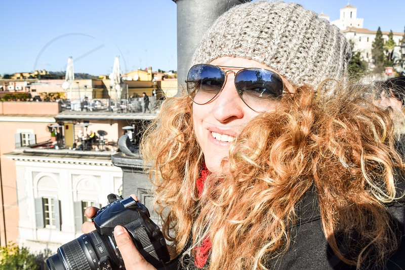 Beautiful Happy Smiling Blonde Young Woman Photographer Wearing Sunglasses And Cap photo