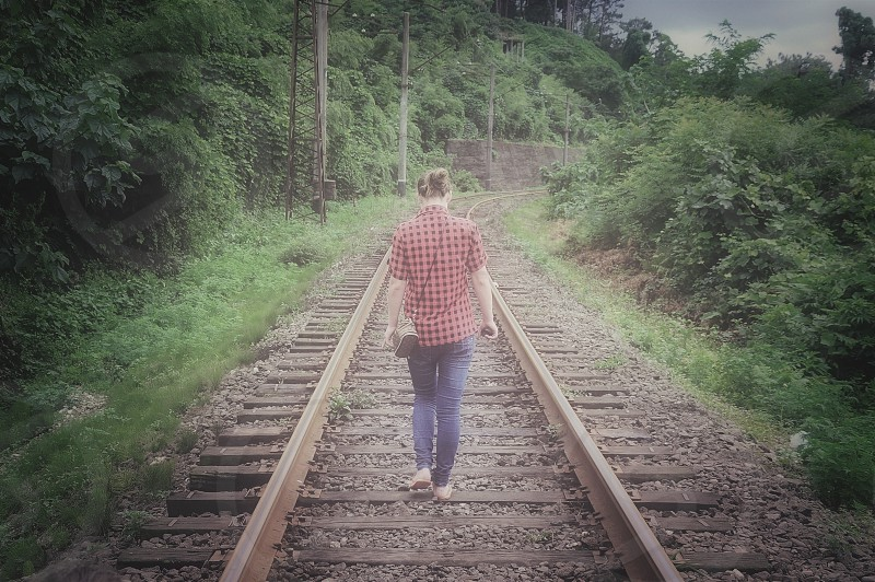 woman walking on railway photo