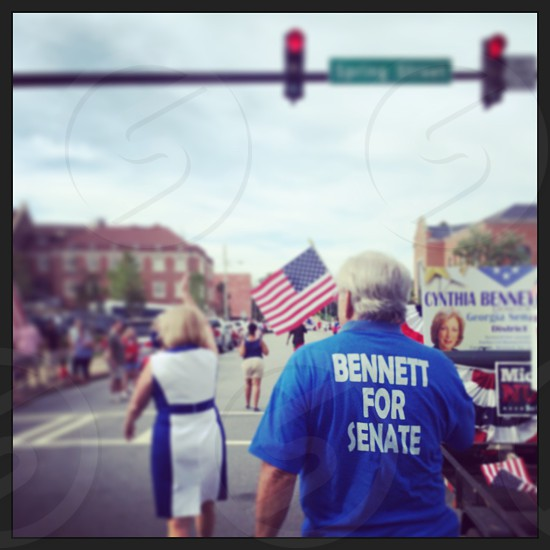 man in blue bennett for senate polo shirt photo