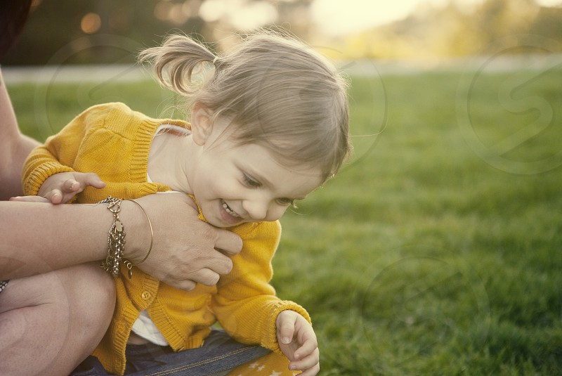 little girl laughing tickle mom happy family mother daughter photo