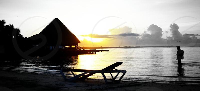 silhouette of beach gazebo and lounger photo