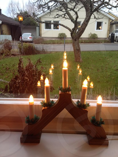 Candle Holder By Glass Window photo
