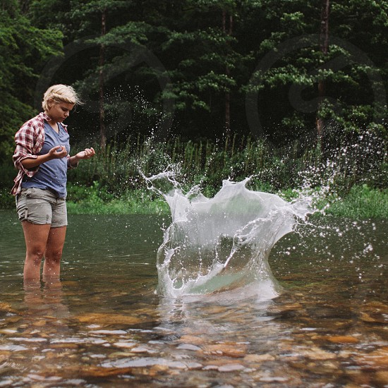 woman standing in creek photo
