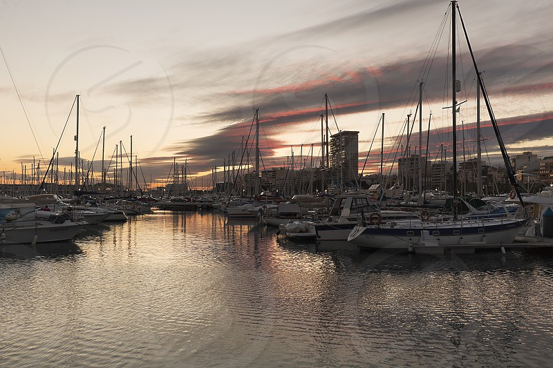 Alicante Spain. February 9 2018: Views of the Port of Alicante during a sunset in winter. photo