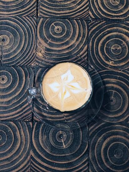 cappuccino coffee on clear mug photo