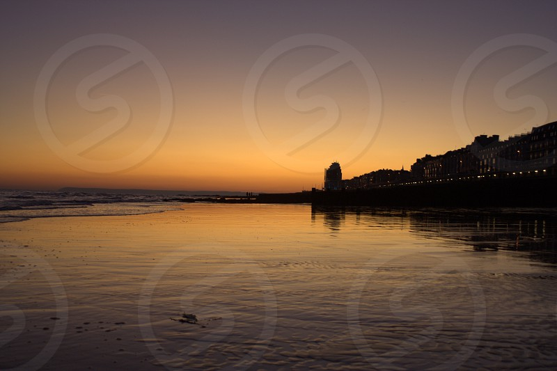 Hastings East Sussex UK beach sunset reflections photo