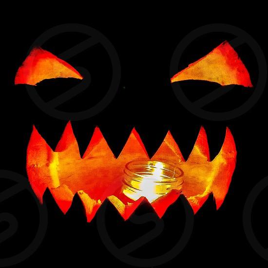 orange jack o lantern with light photo