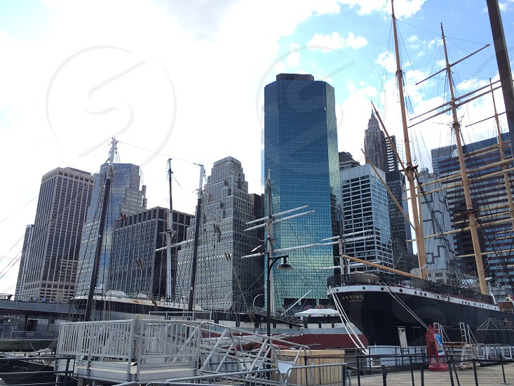 black ship and high rise glass window building photo