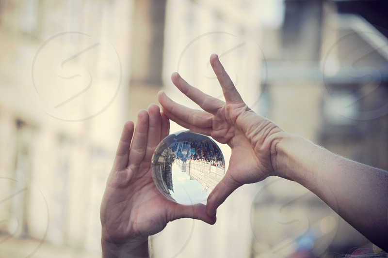 Reflection city edinburgh hands artist crystal ball photo