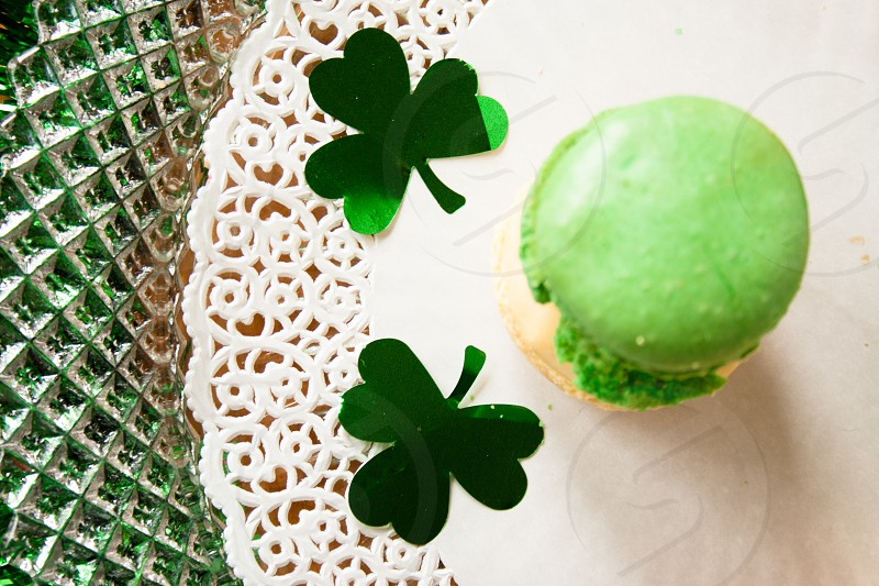 Green macaroons with shamrocks on plate photo