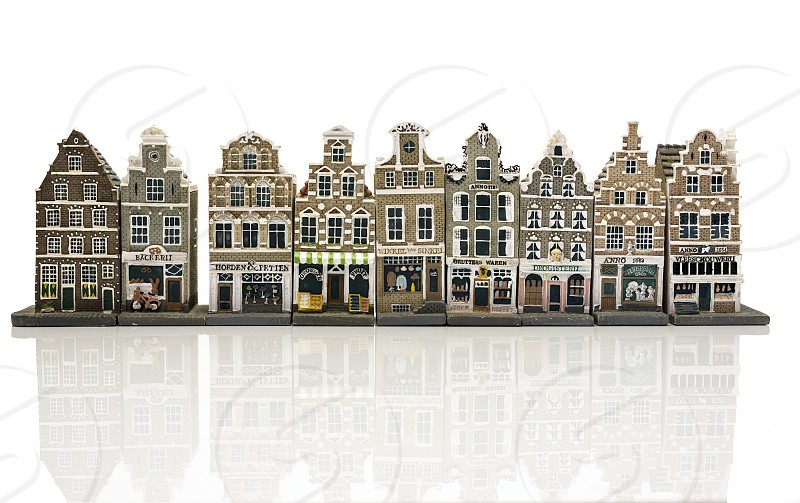 miniature model houses  shops as in old Amsterdam Holland isolated on white background photo