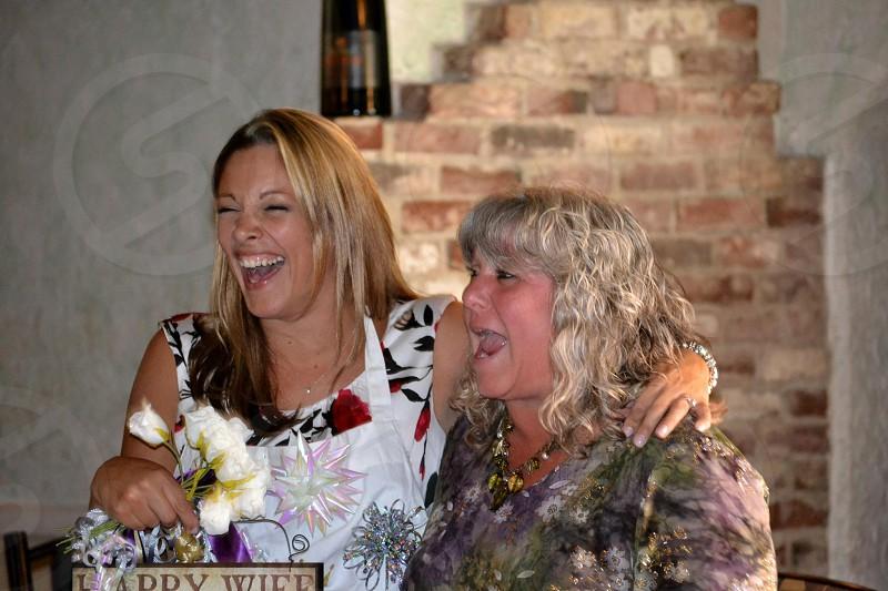 2 women smiling photo