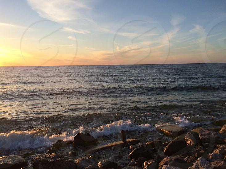 photo of sea horizon under clear blue sky photo