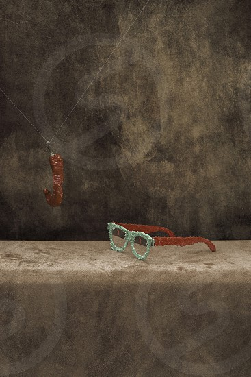 Still life with plastic glasses and dry hot pepper surrealism photo