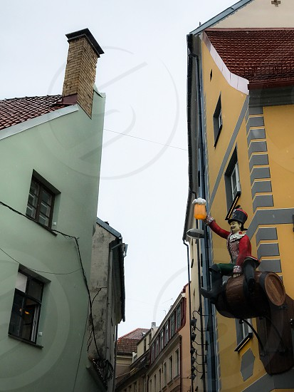 Outdoor day colour square filter Riga Latvia Europe European Architecture buildings spire traditional culture old decorative ornate sky travel tourism tourist wanderlust colourful alley road narrow street beer soldier figurine sculpture fun photo