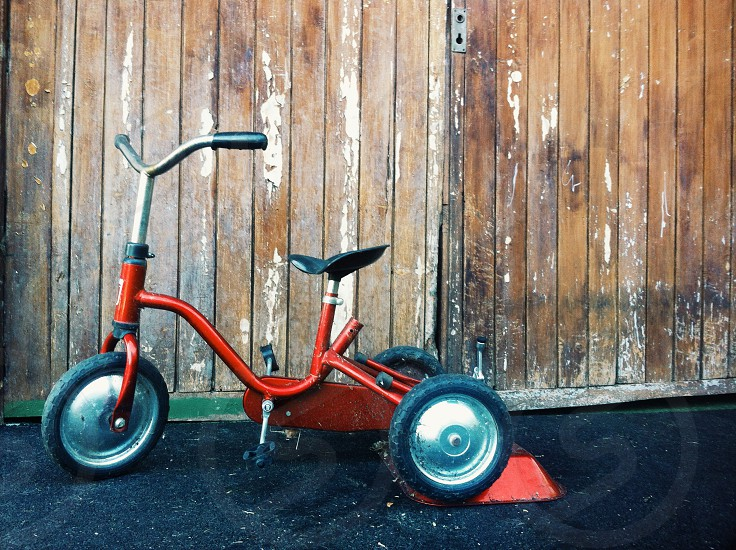 red and silver tricycle bike photo
