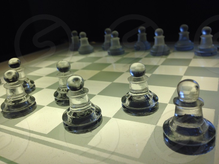 gray and white chessboard with chess pieces photo