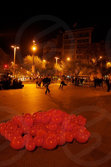 red balloons on grey concrete road photo