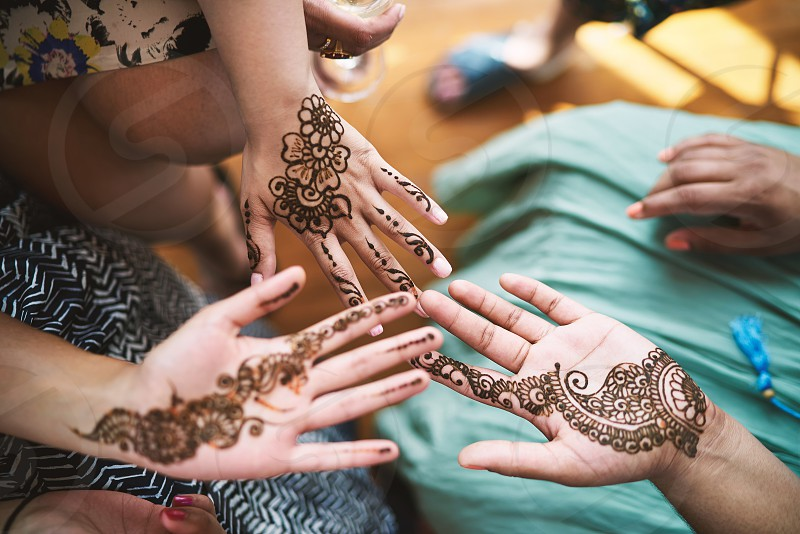 Indian women showing hand with henna tattoo art (Mehndi) on the indian wedding day photo