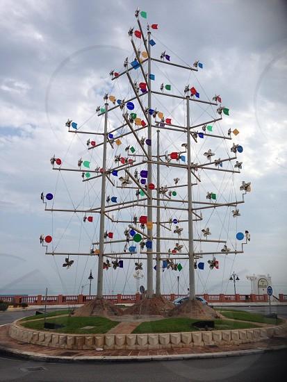 Art on a roundabout wind catchers windmills weather  photo