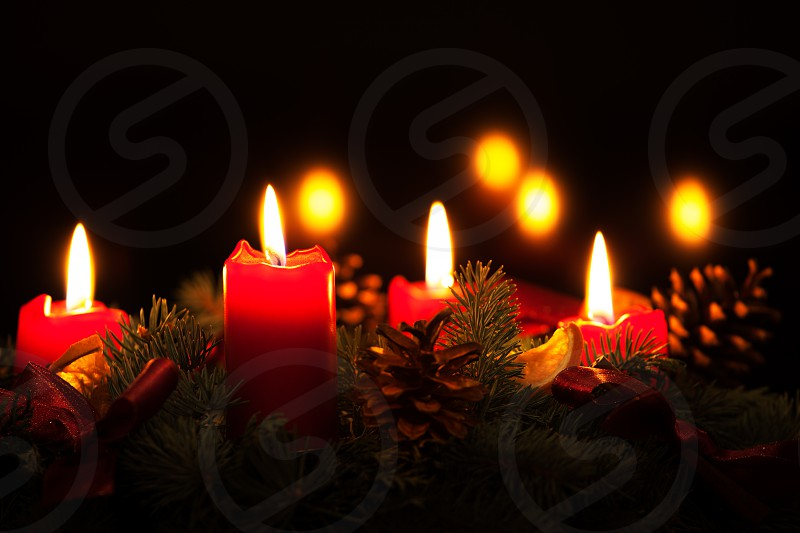 Christmas wreath with burning red candles photo