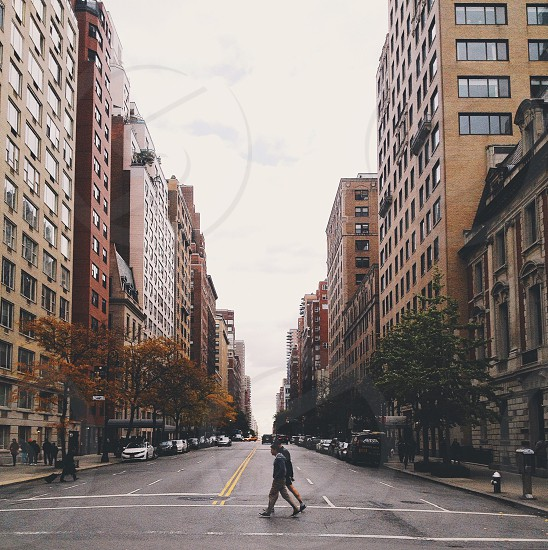 two person crossing street photo