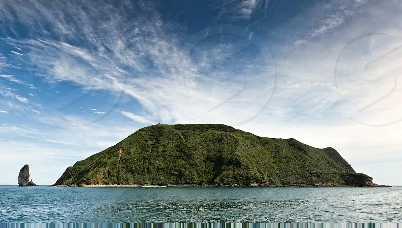 Beautiful seascape of Kamchatka Peninsula (panorama): Starichkov Island in Avacha Bay Pacific Ocean on a sunny day. photo