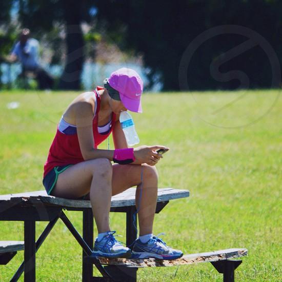 Runner sitting on Picnic table photo