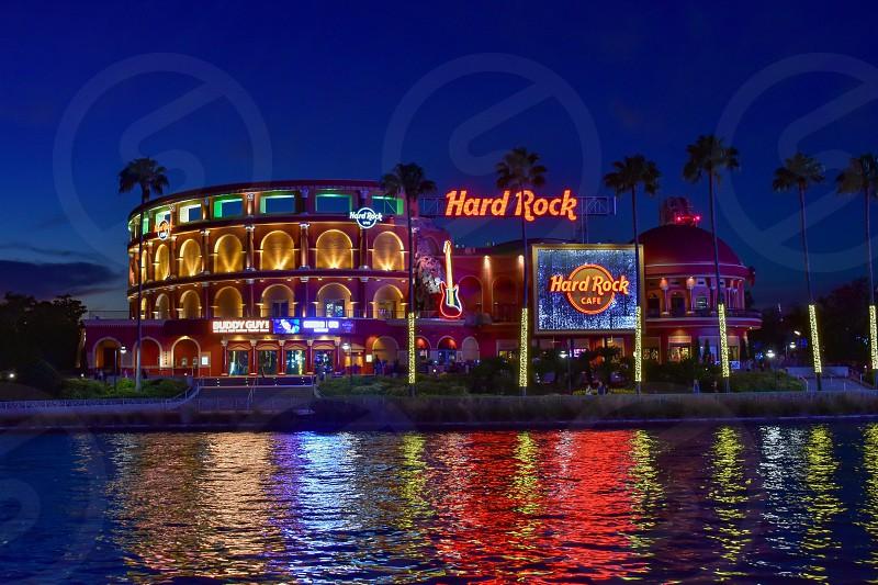 Orlando Florida. February 05 2019.  Panoramic view of colorful and illuminated Hard Rock Cafe on blue night background at Universal Studios area. photo