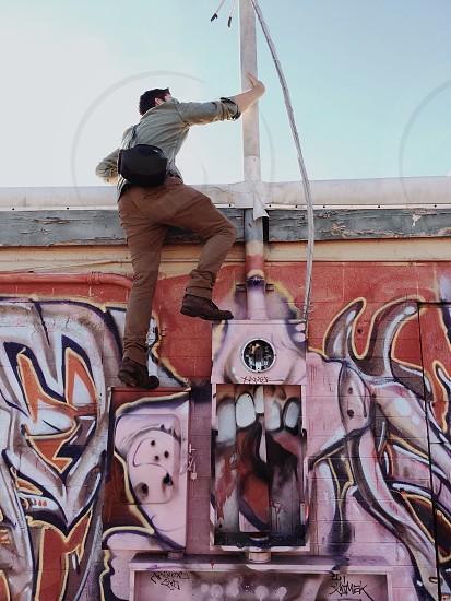 man in brown pants photo
