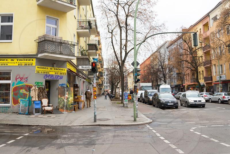 Vintage shop and international restaurant can be found inside Neukolln Neighborhood in Berlin Germany photo