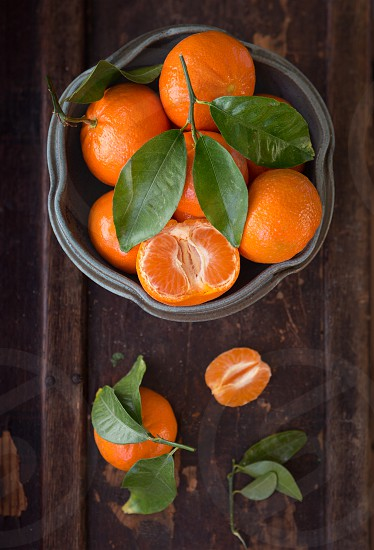 Overhead view of tangerines on a rustic wooden surface photo