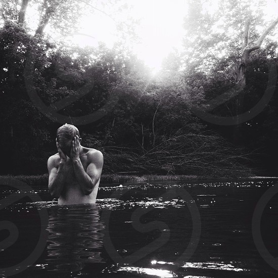 man swimming and holding his head photo