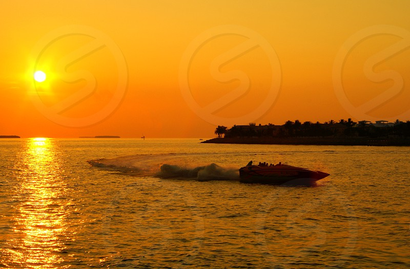 red speedboat on water photo