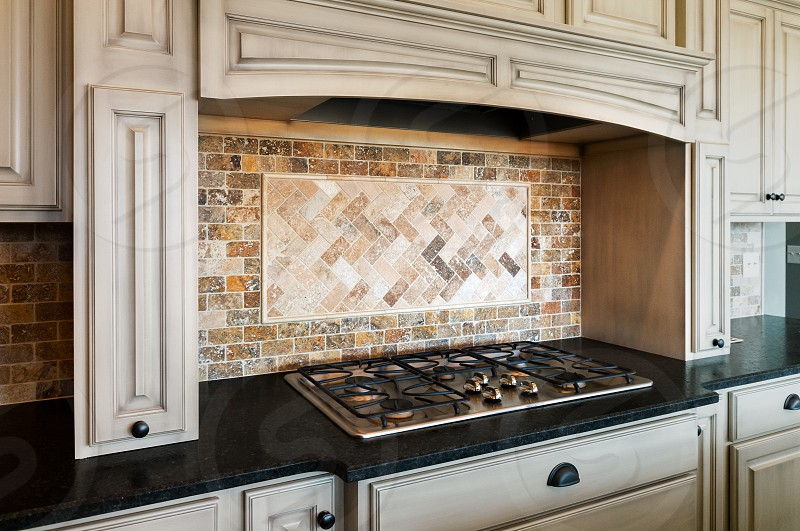 Architectural detail range with tile backsplash photo