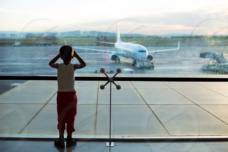 Airport boy miss wait love fly happy guy baby plain photo
