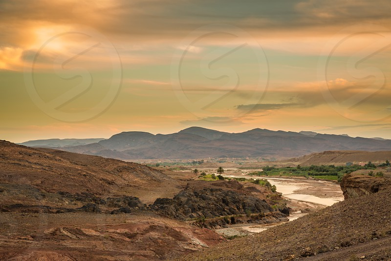 Dusk over wadi in the foothills of the Atlas Mountains in Morocco. photo